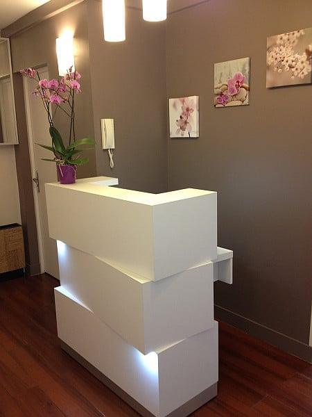 Zen-Modern-White-Small-Reception-Desk-with-Downlighters-In-Situ