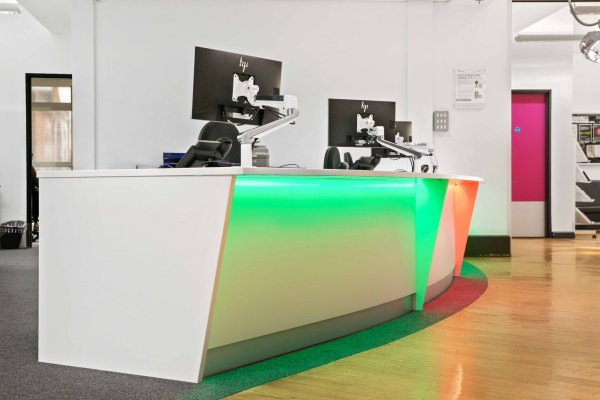 Bespoke Angled Reception Desk with Coloured Downlighting
