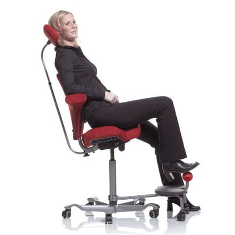 Woman-Leaning-Back-In-HAG-Capisco-Office-Chair-With-Headrest-and-Footrest