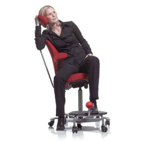 Woman-Sitting-In-HAG-Capisco-Office-Chair-With-Headrest-And-Footrest