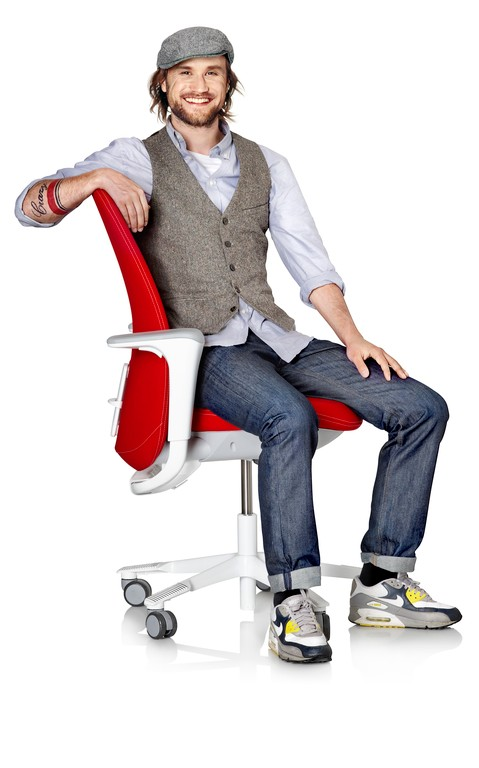 Man-Sitting-in-Red-HÅG-SoFi-with-SlideBack™-Arms