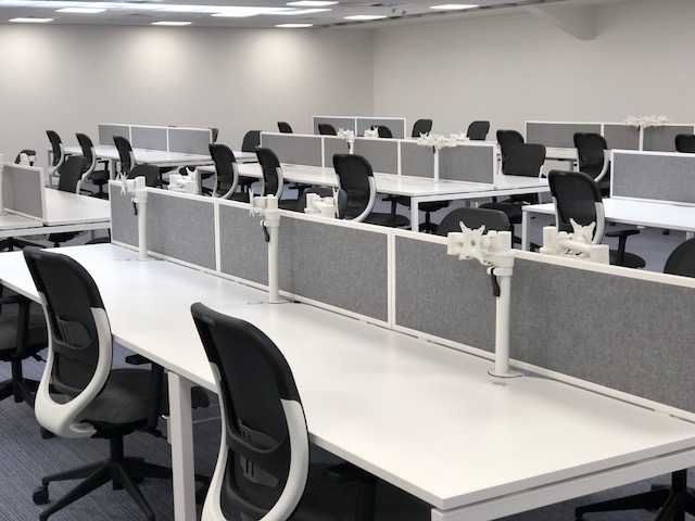 Bench Desking with Monitor Arms in Office