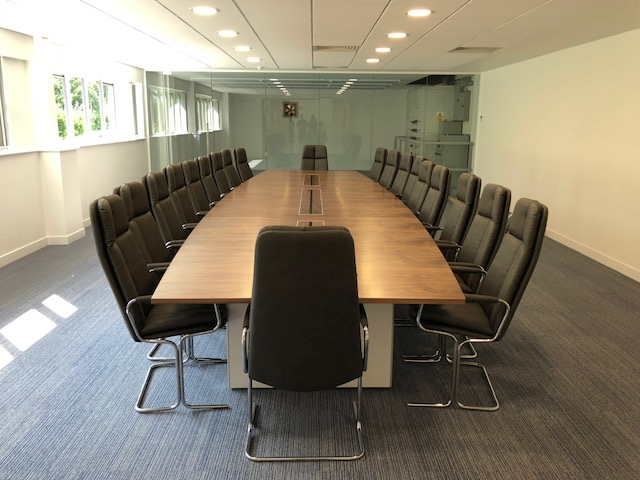 Faux Keather Chairs and Veneer Boardroom Table