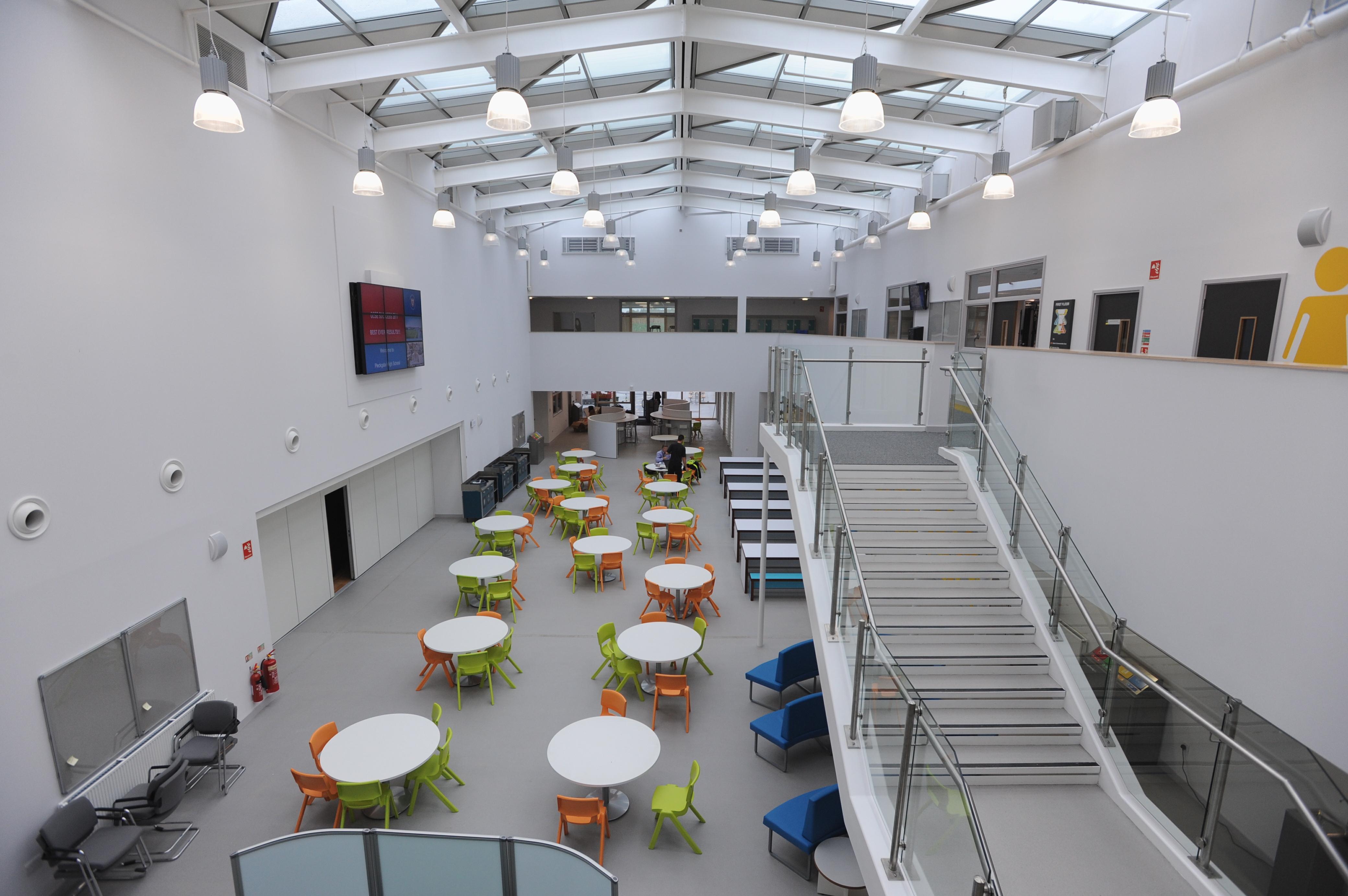 Orange-Green-Plastic-Postura-Plus-Chairs-In-Atrium-Area