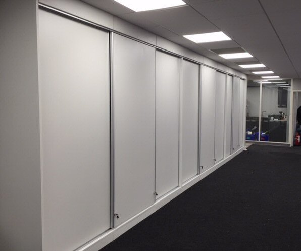 Storage Wall with Sliding Doors