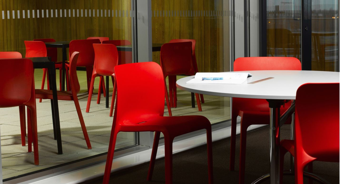 Red Plastic Chairs at Meeting Table