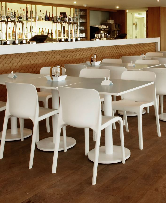 White Plastic Chairs in Bar Seating Area