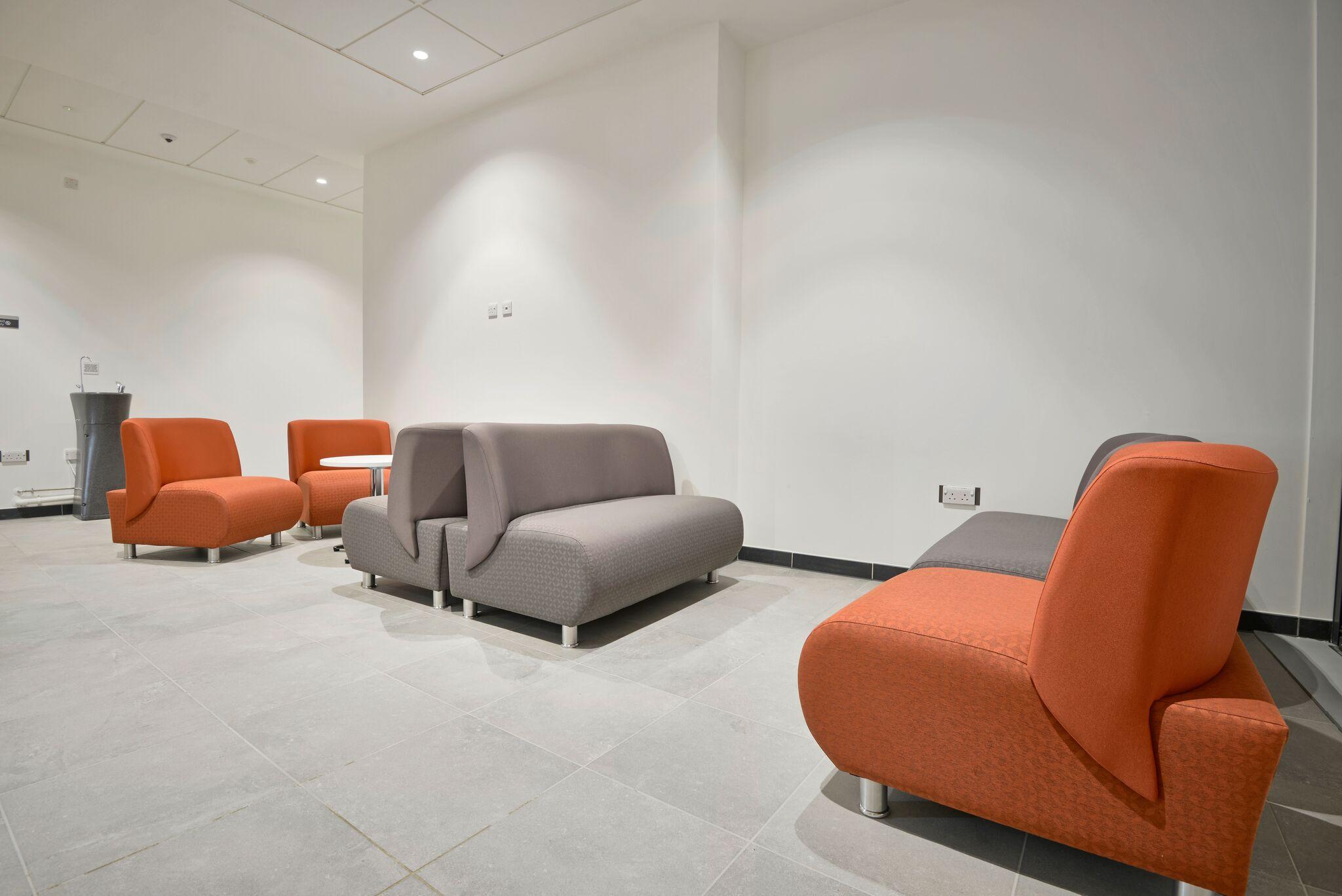 Grey and Orange Modular Sofas In Situ