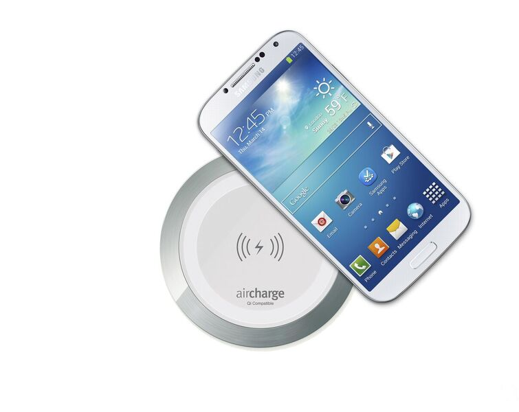 White Aircharge Wireless Surface Charger with Samsung Phone