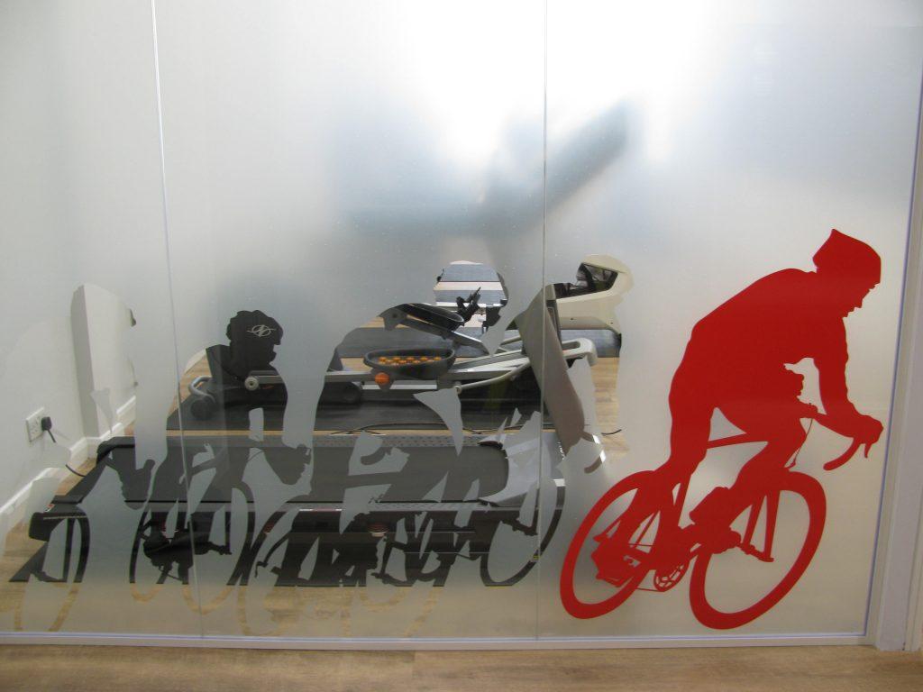 Staff-Gym-Wall-Glass-Manifestation-Cyclists