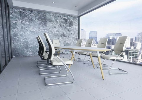 Moment-Modern-White-Oval-Top-Meeting-Table-Wooden-Legs-In-Boardroom-Set-Up