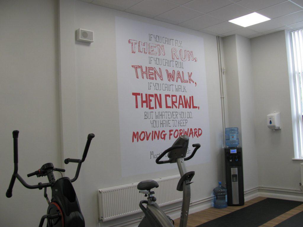 Custom-Imagery-On-Staff-Gym-Wall